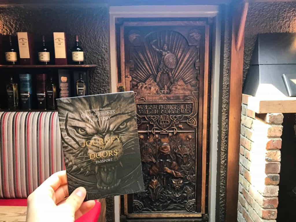 photo of one of the Game of Thrones doors, one of the many Game of Thrones related things to do in Northern Ireland. The door is made out of wood and carved into it is a scene from Game of Thrones.