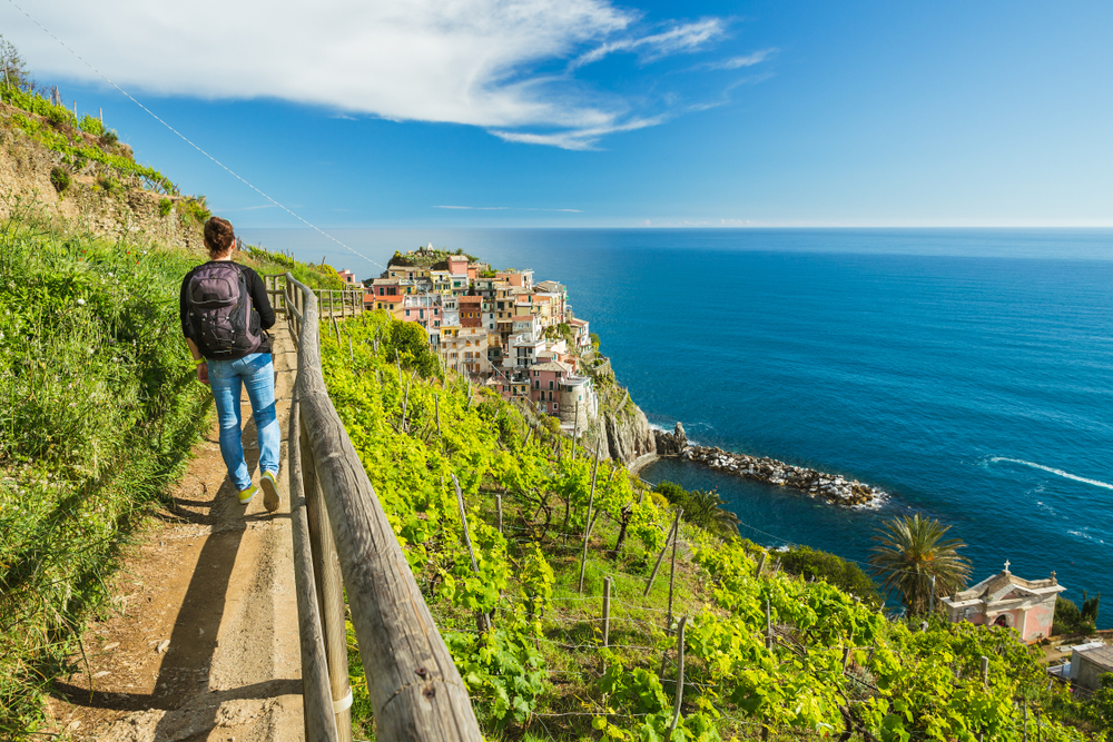 Woman hiking among the vineyards of Manarola