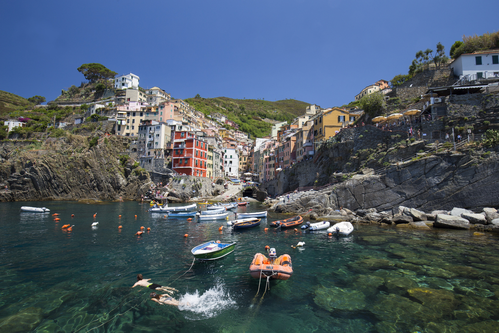 Swimmers enjoying the rocky shore line of Riomaggiore