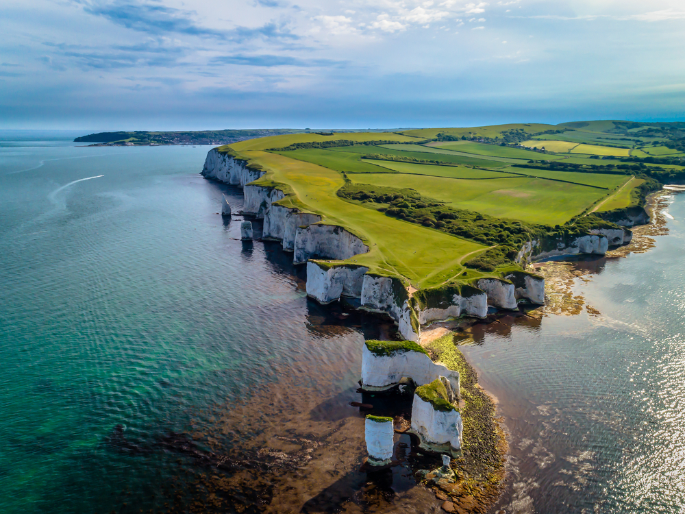 a drone photo of Old Harry Rocks, a natural chalk formation located off the Dorset coast in southern england