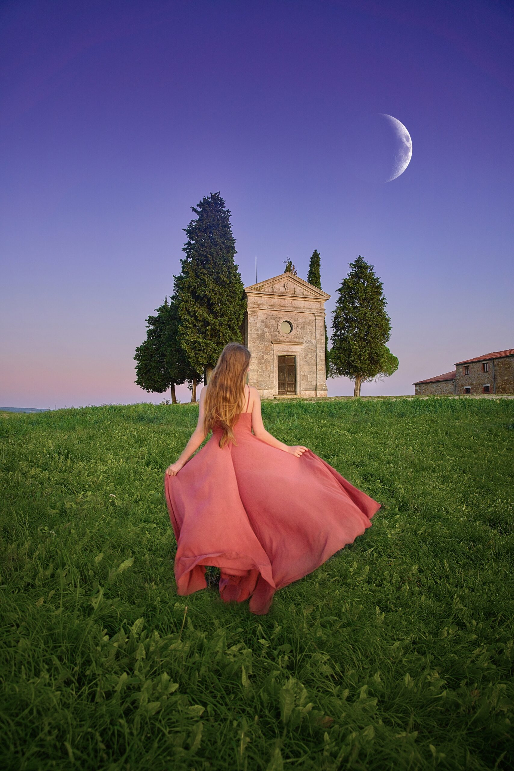 Girl walking in front of Chapel Of Our Lady Of Vitaleta in Tuscany