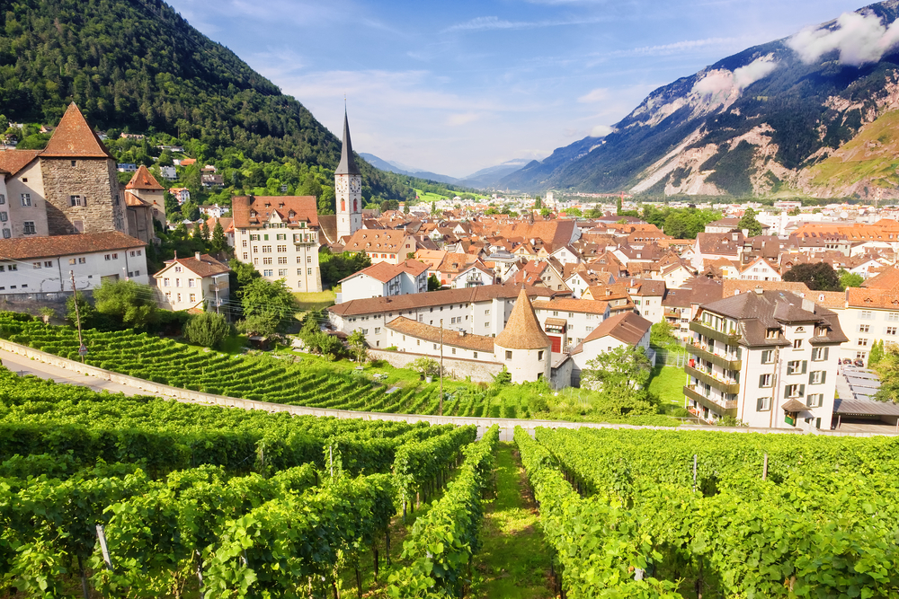 Chur is the oldest and most authentic of all small towns In Switzerland, the town is the background with vines in the foreground and traditional Swiss builds as far as the eye can see.