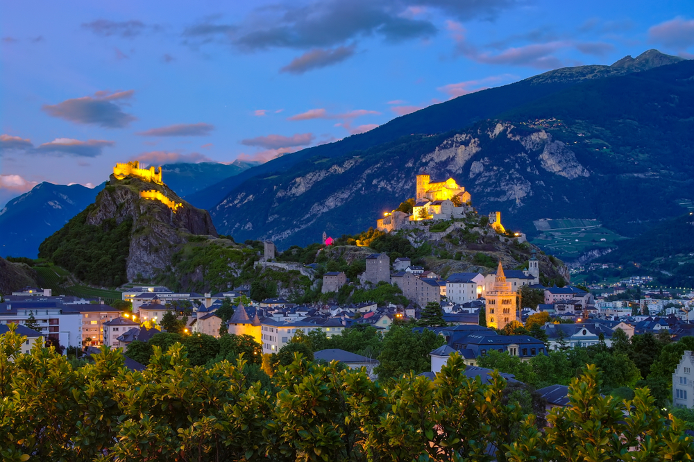 The beautiful town of Sion guarded by two towers on rocky outcrops. I truly delight among all the small towns in Switzerland