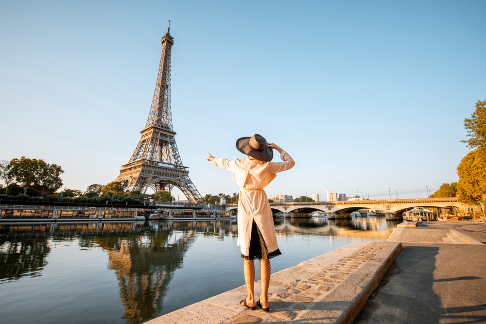 Photo of woman looking at the Eiffel Tower