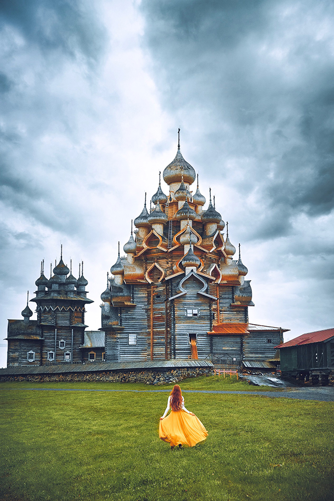 Hidden Gems in Europe Kizhi Island church with girl in front