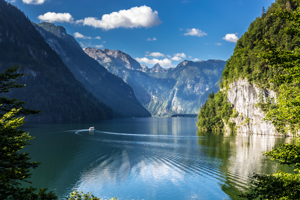 Lake Konigssee's crystal clear waters bumping right up against sheer cliffs.