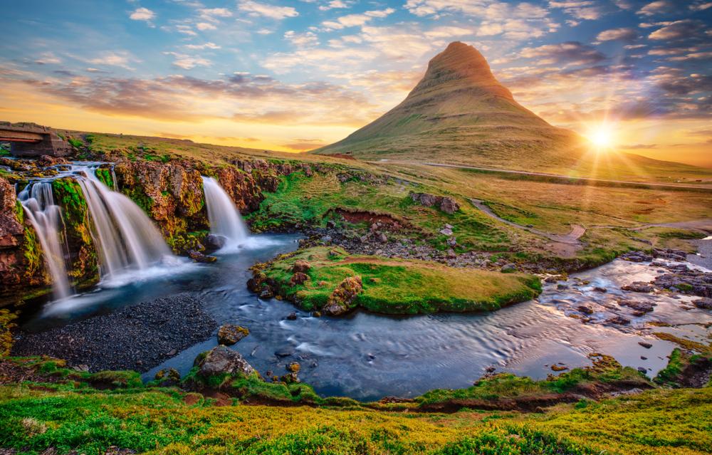 The beautiful waterfall of Kirkjufellsfoss with an impressive mountain in the background