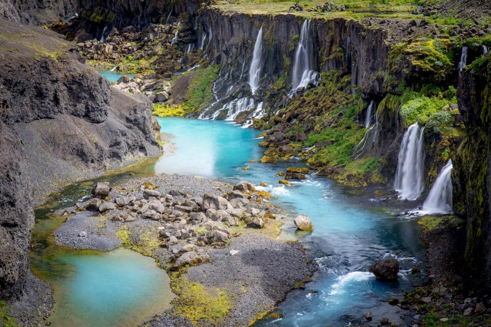 Sigoldugljufur a photographers dream with vivid blue water and multiple cascades
