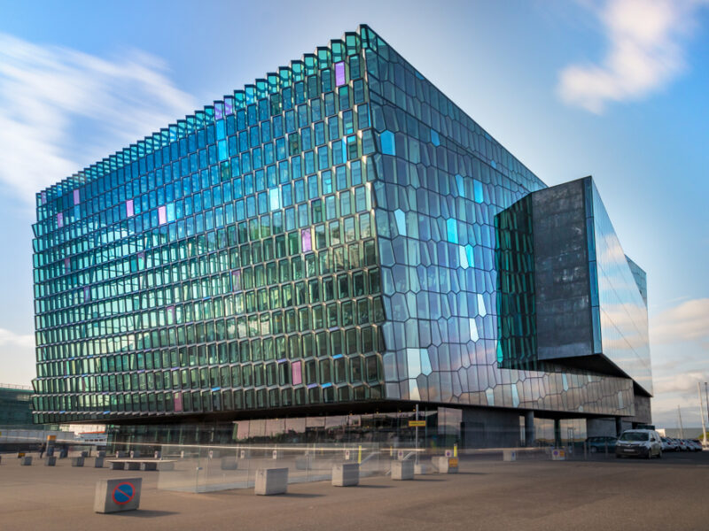 The Harpa center in Reykjavik with its many windows and boxy architectural design.