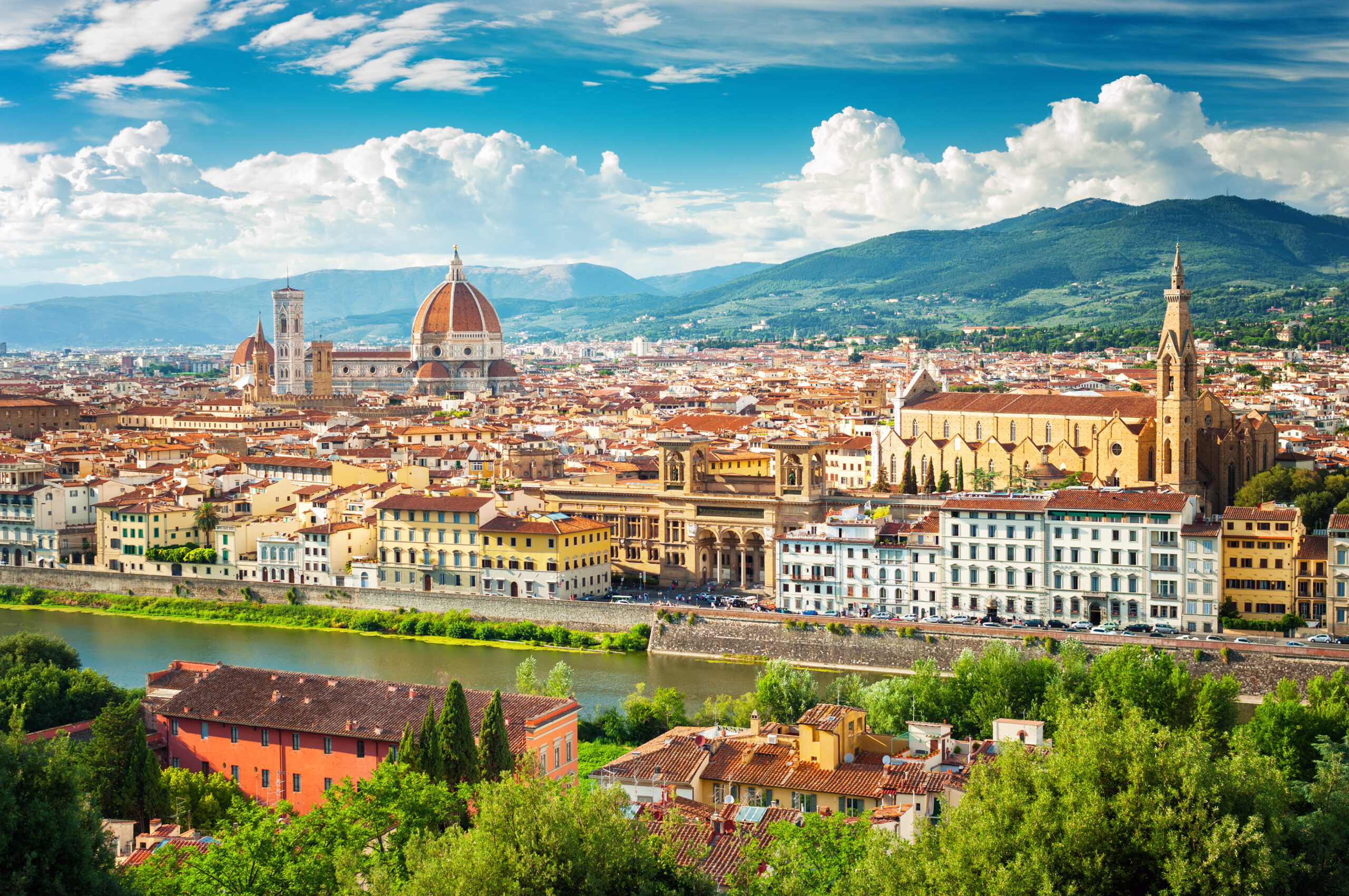 Photo of Florence (Firenze) cityscape, Italy. Featuring city of Florence with many buildings including a church.