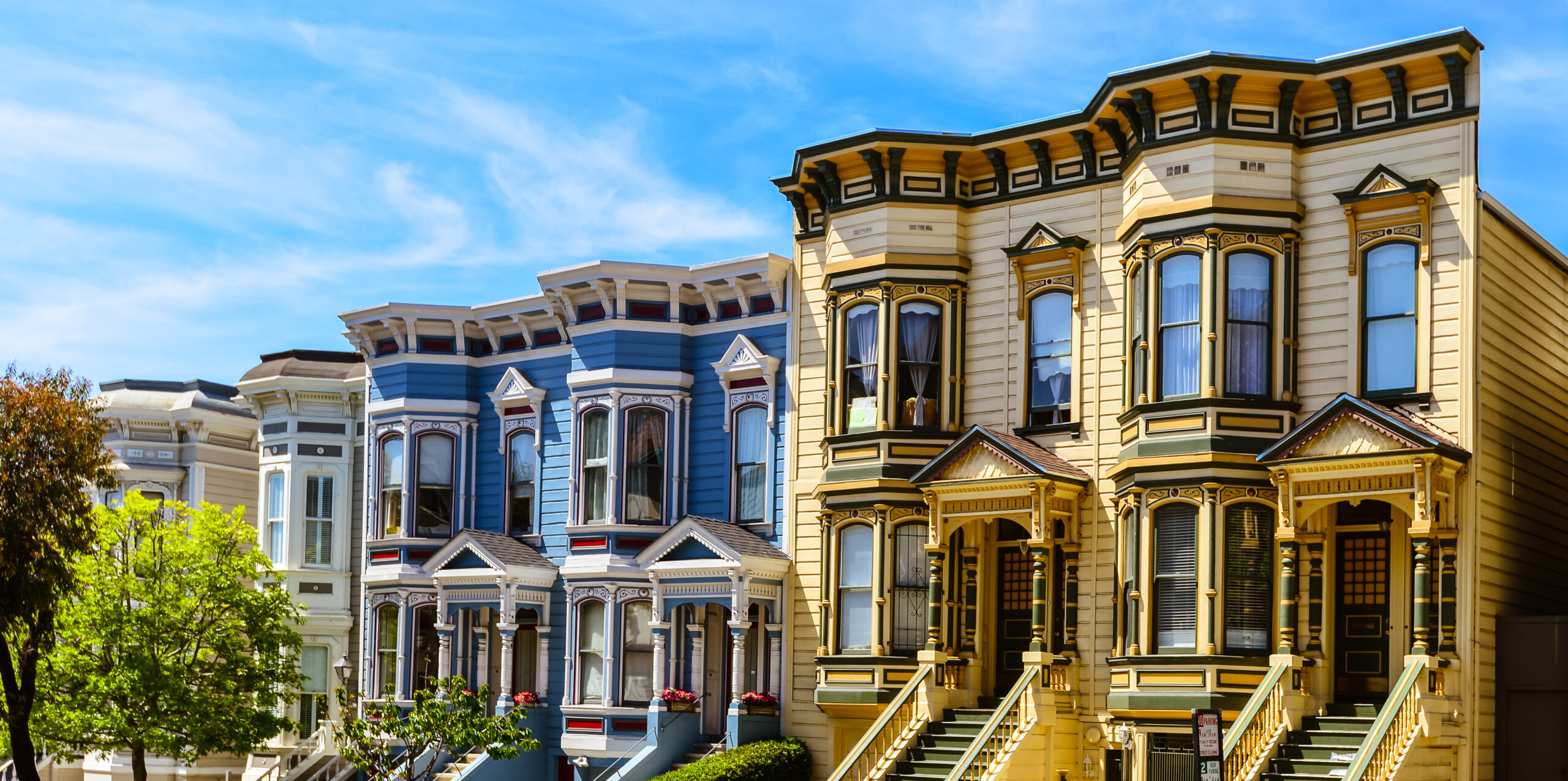 Photo of Haight and Ashbury neighborhood featuring quintessential Victorian homes.