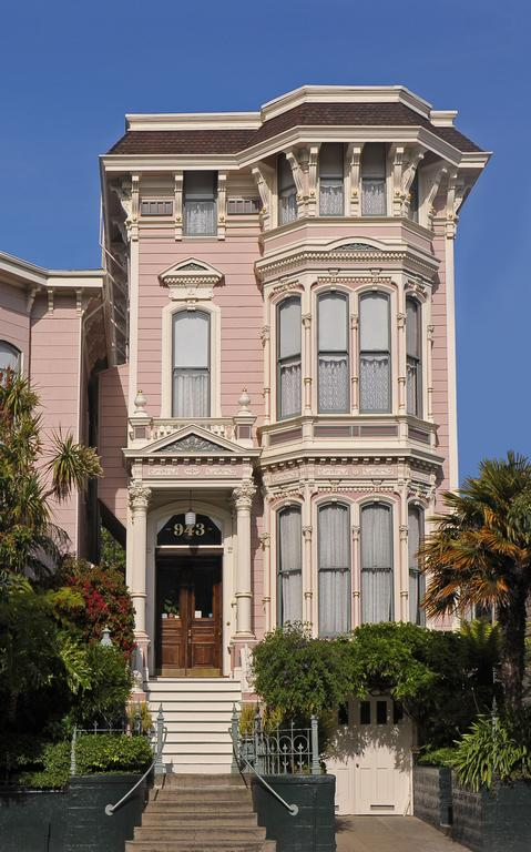 Photo of the front of the Inn San Francisco in the Mission District. One of the best places to stay in San Francisco. A Victorian style building with pale pink paint and a wooden front door is featured.