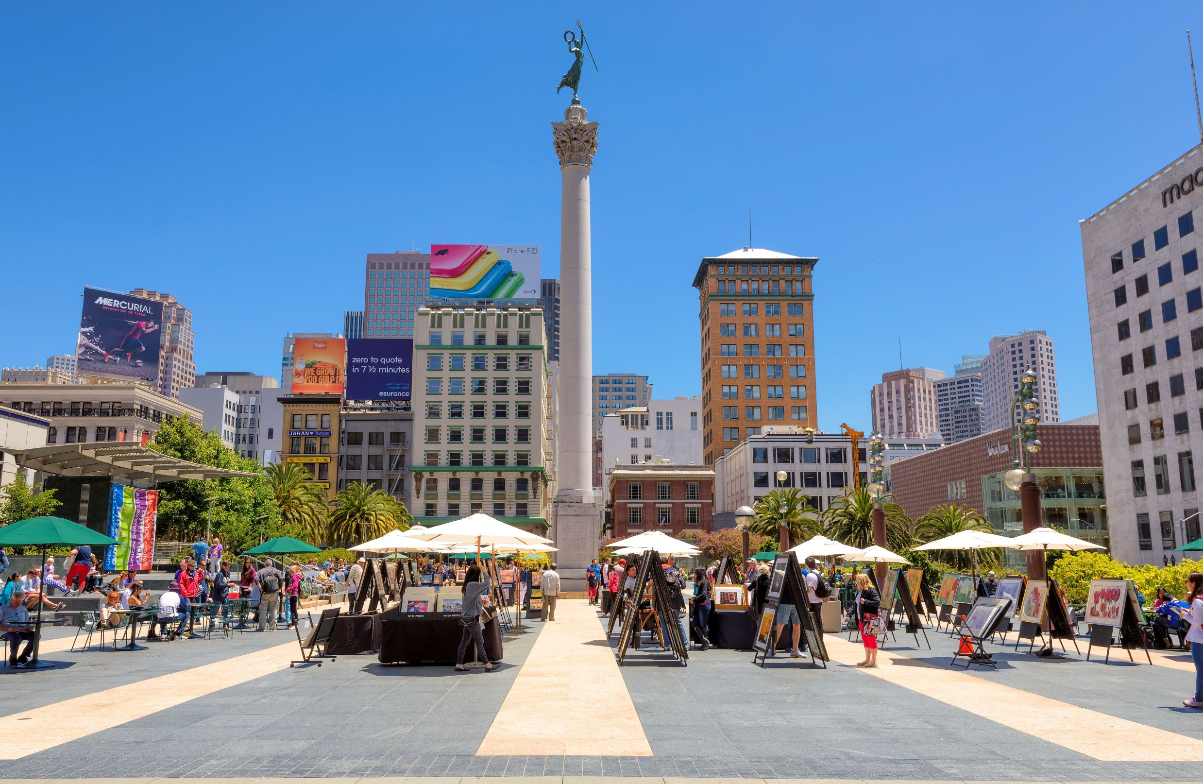 Photo of Union Square in, one of the best places to stay in San Francisco. Photo features main tall buildings with a main square holding an art show.