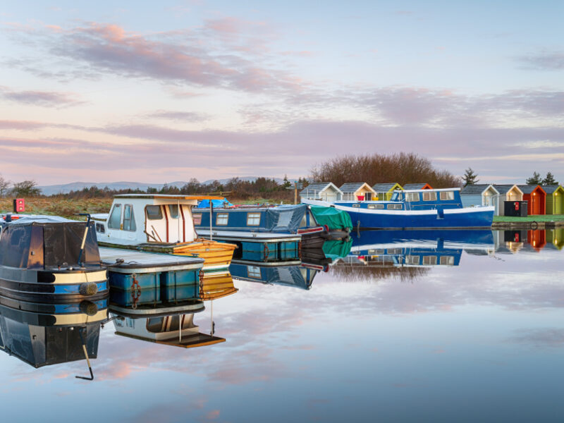 Colorful boats on the channel in Falkirk, one of the most charming towns in Scotland