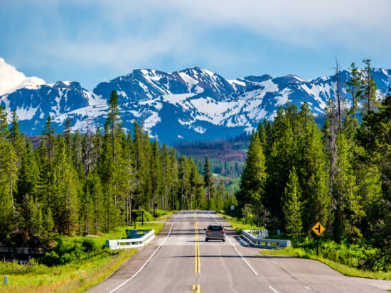Photo of car driving in Yellowstone.