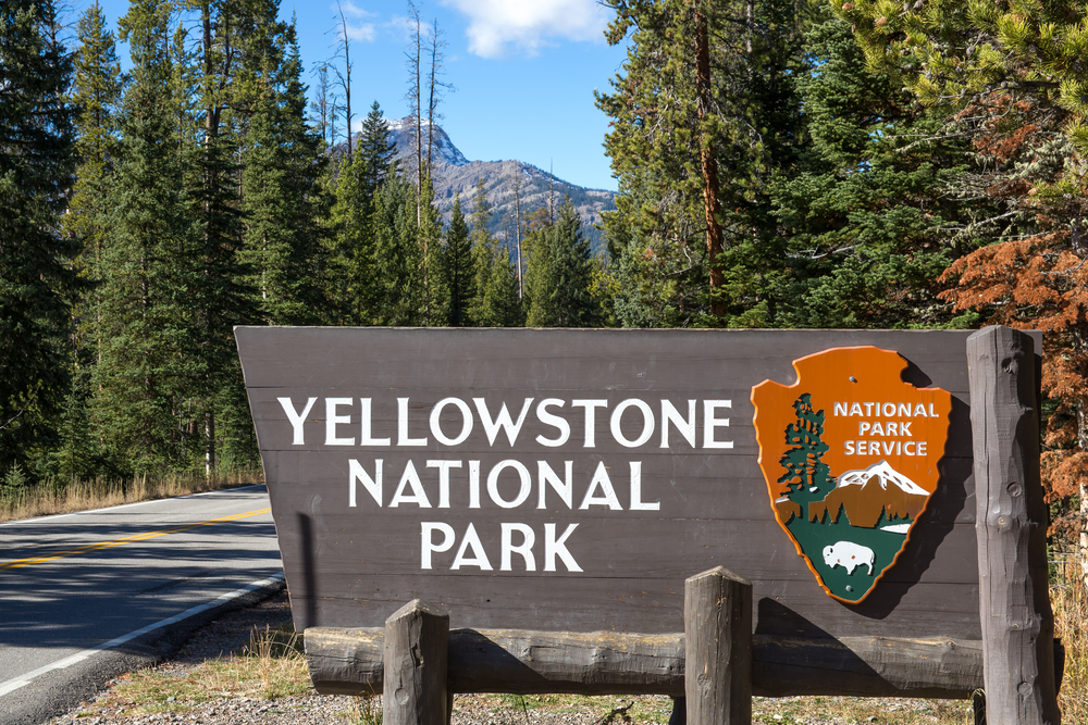 Photo of park sign announcing your Yellowstone road trip