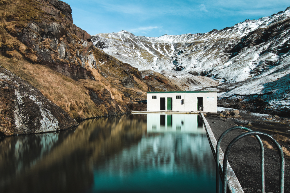 the Seljavallalaug swimming pool during your trip to Iceland in October