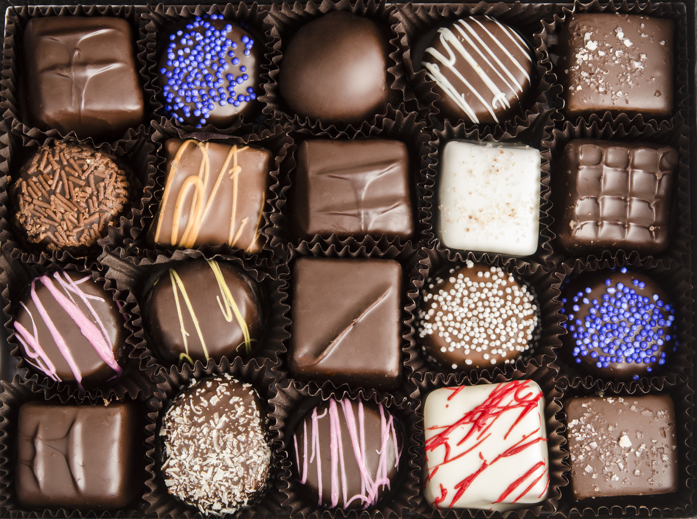 Photo of a decadent box of assorted chocolates.