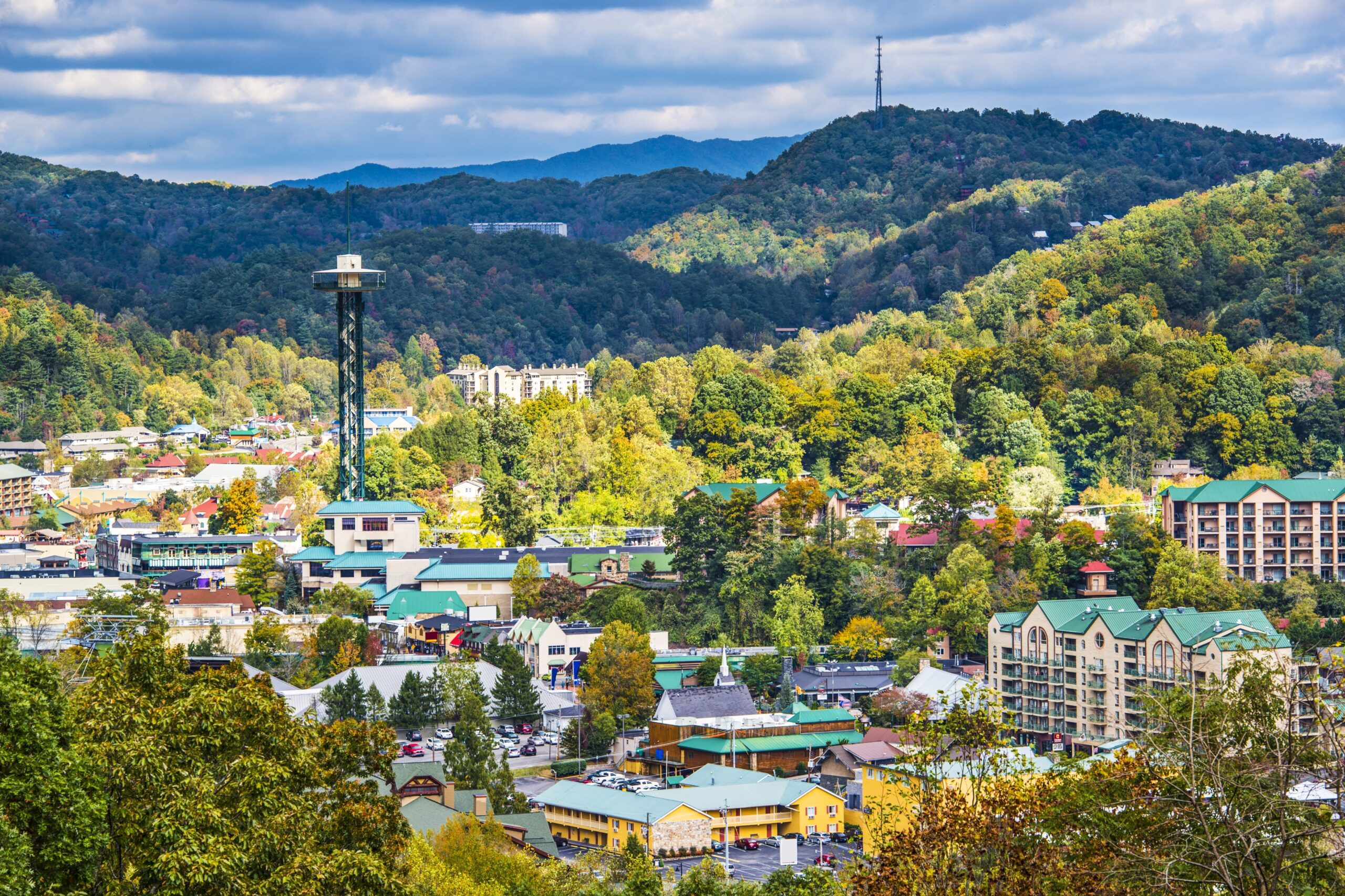 An aerial view of the Gatlinburg Space needle and the surrounding landscape.
