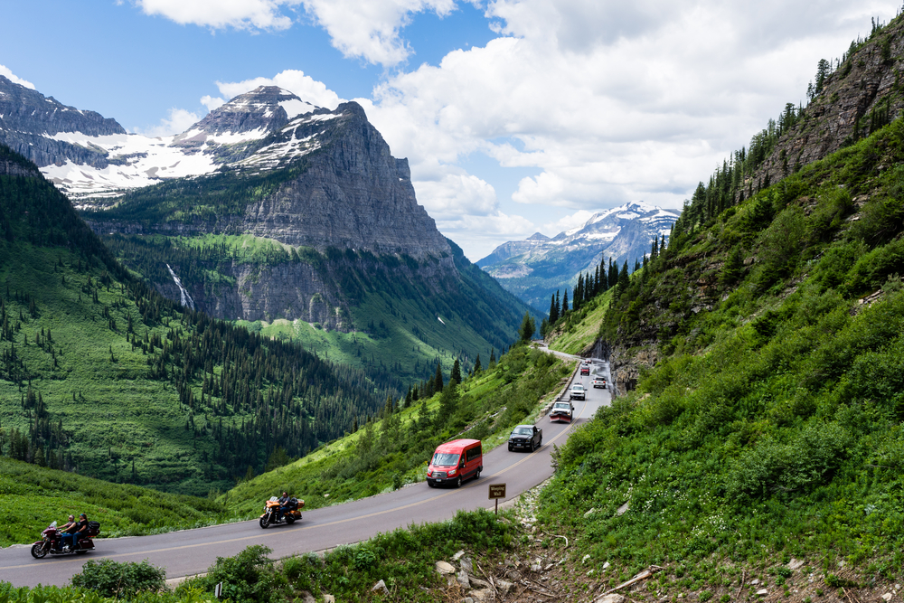 driving through Glacier National Park on one of the best road trips in the USA