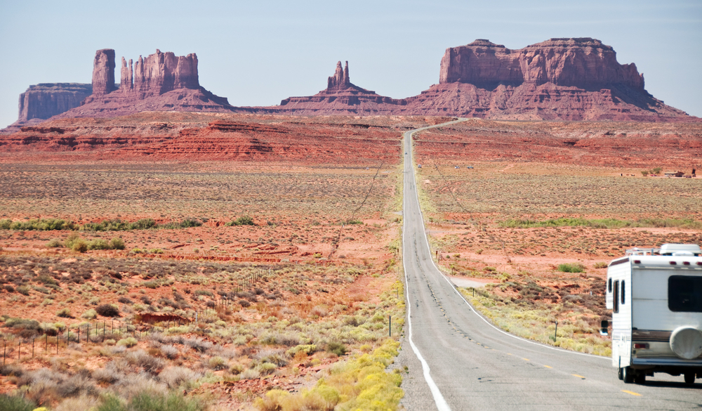 driving towards Monument Valley on one of the best road trips in the USA