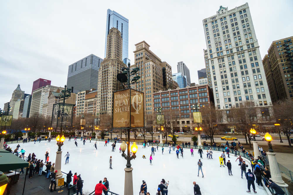 Chicago at Christmas people skating on a ice rink.