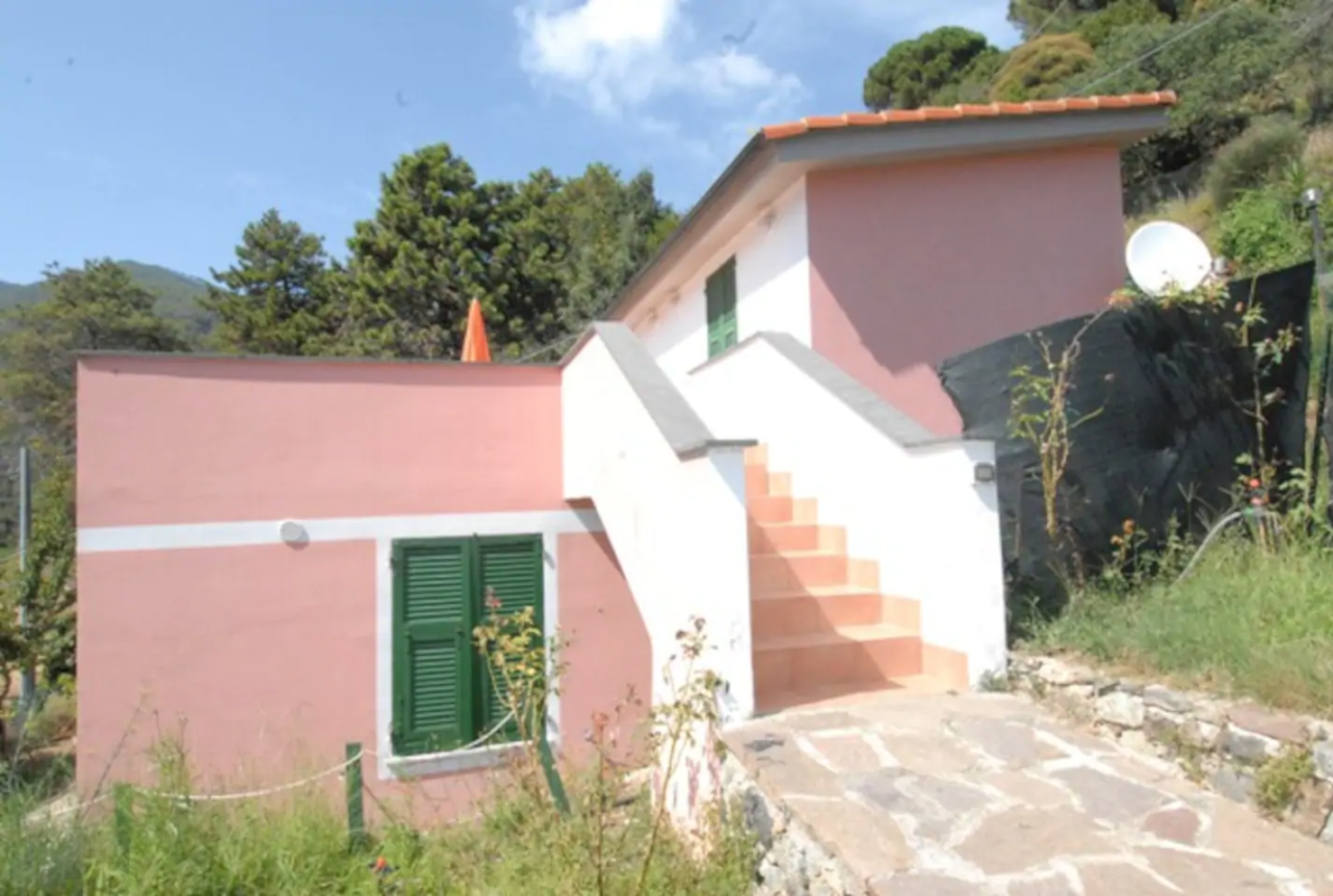 pink apartment building in Monterosso. Just one of the great airbnbs in cinque terre