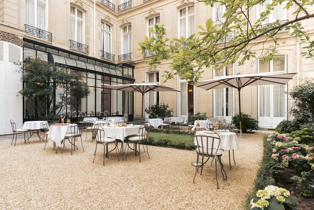 Photo of outdoor terrace with seating at Hotel Alfred Sommier located in Paris.