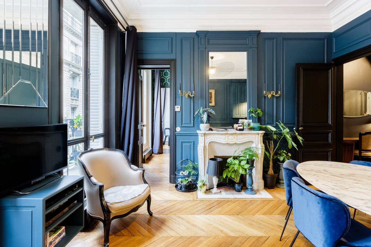 Photo of beautiful living room at an elegant apartment Airbnb in Paris.