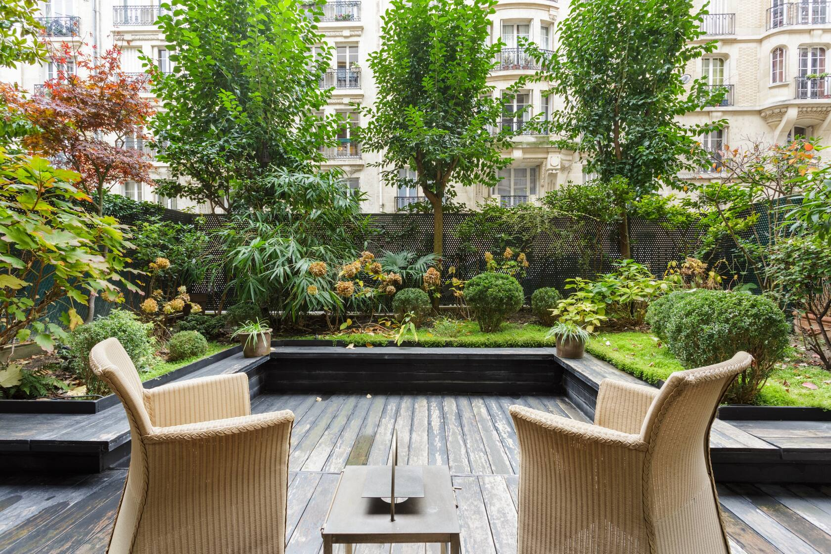 Photo of a garden patio at an apartment Airbnb in Paris.