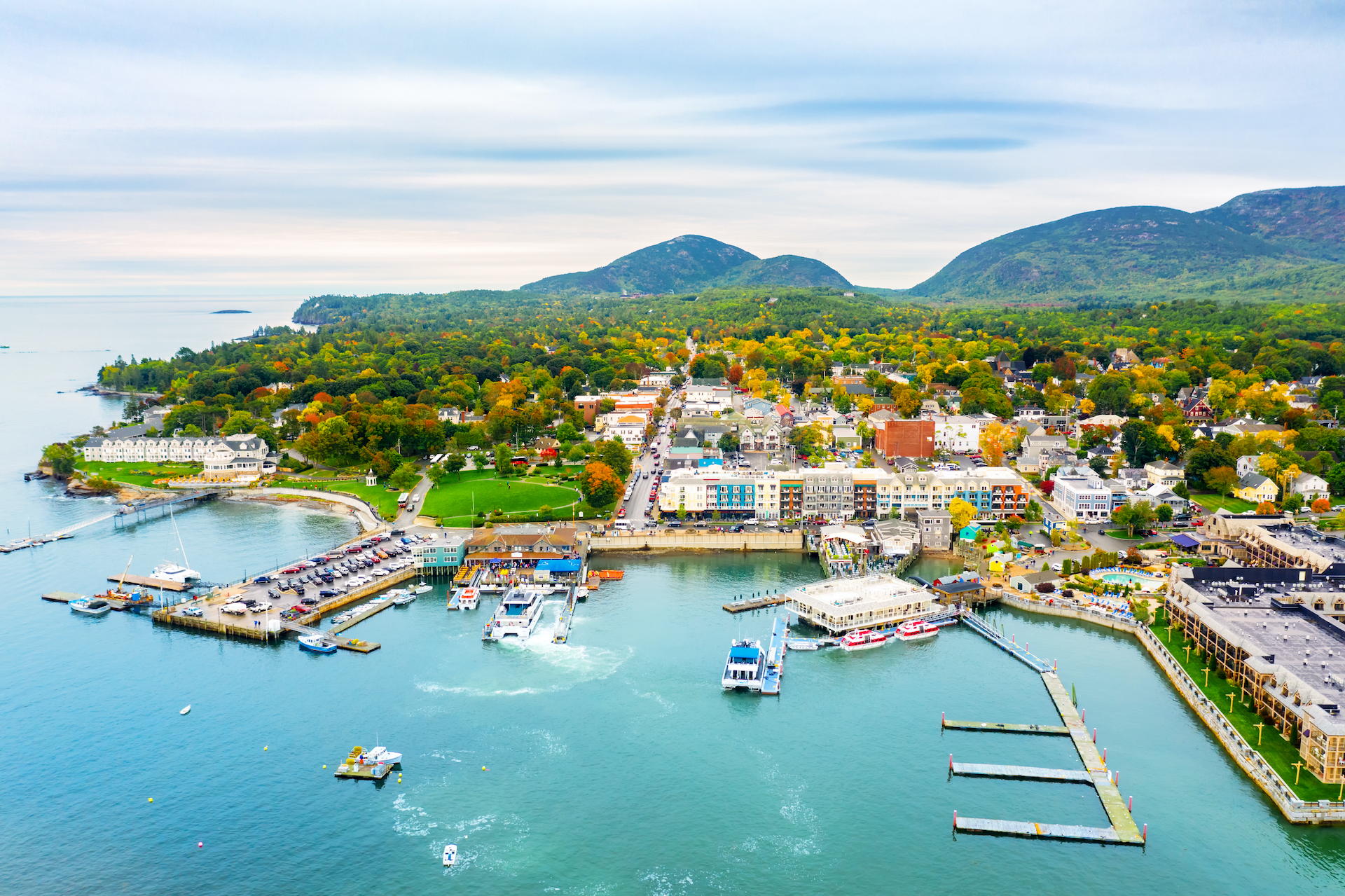 aerial view of teal waters and colorful buildings of Bar Harbor, Maine