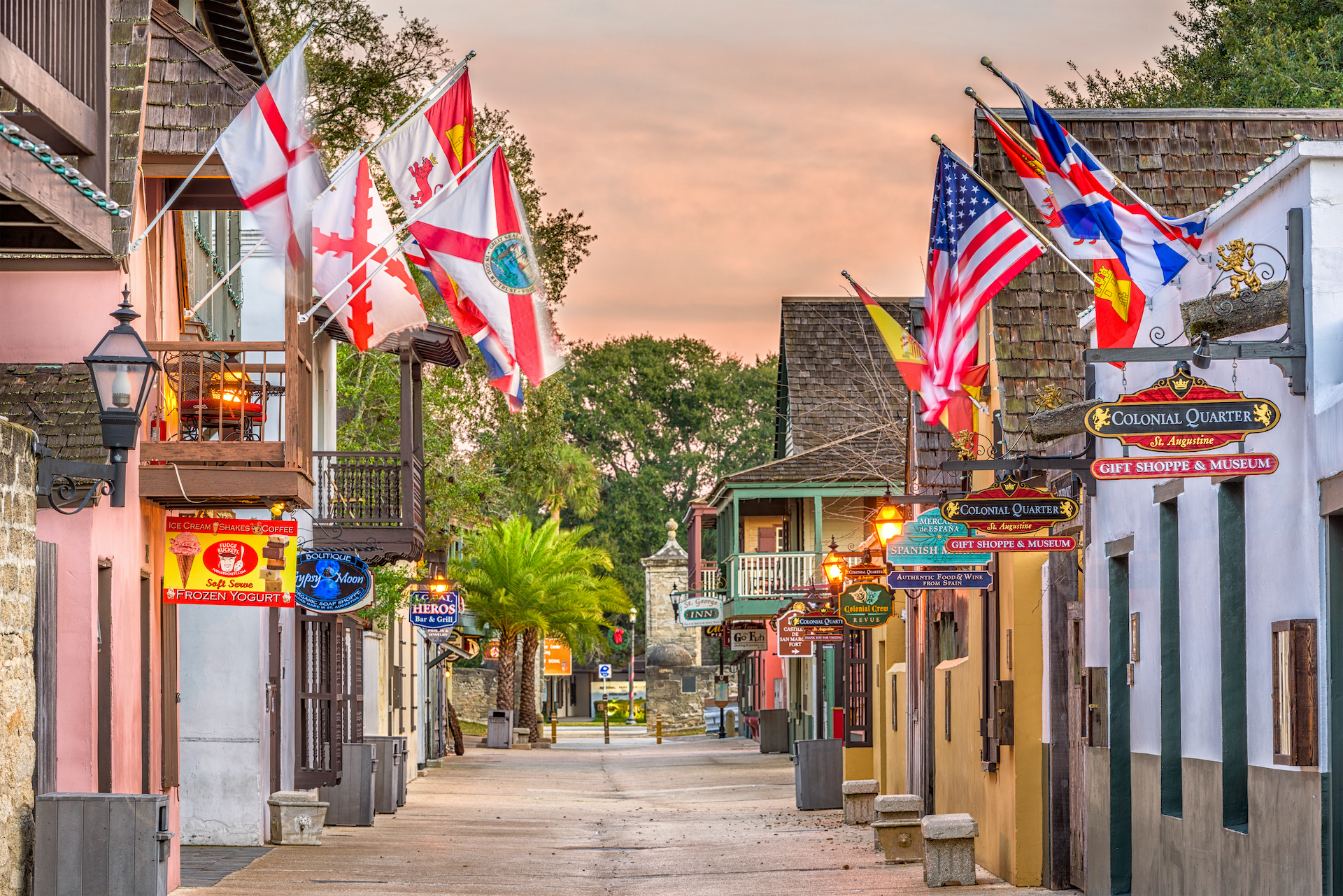 international flags lining small st. augustine street small towns in America