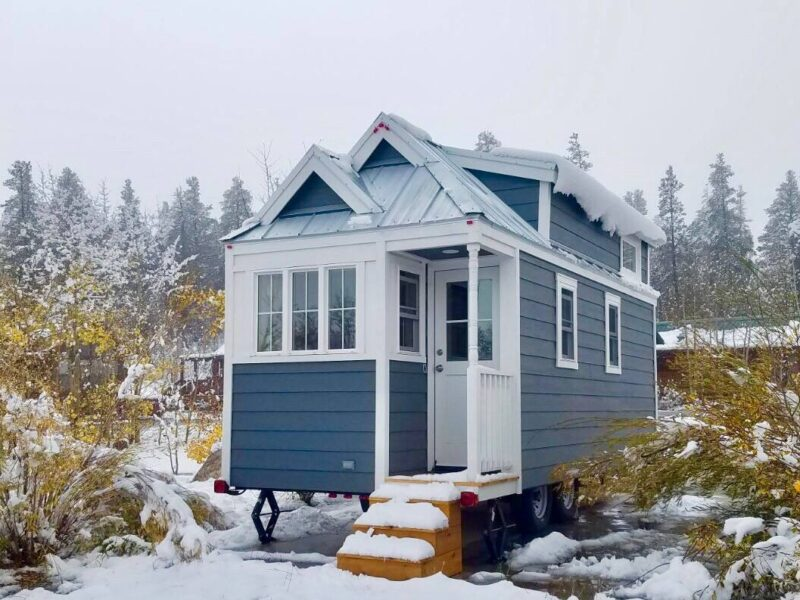 A tiny blue house in snowy surroundings