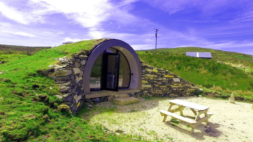 This cropped airbnb in Ireland resides under hills and mountains and is perfect for a getaway