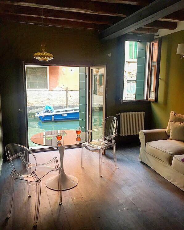This waterfront airbnb offers great views of teh canal at eye level!