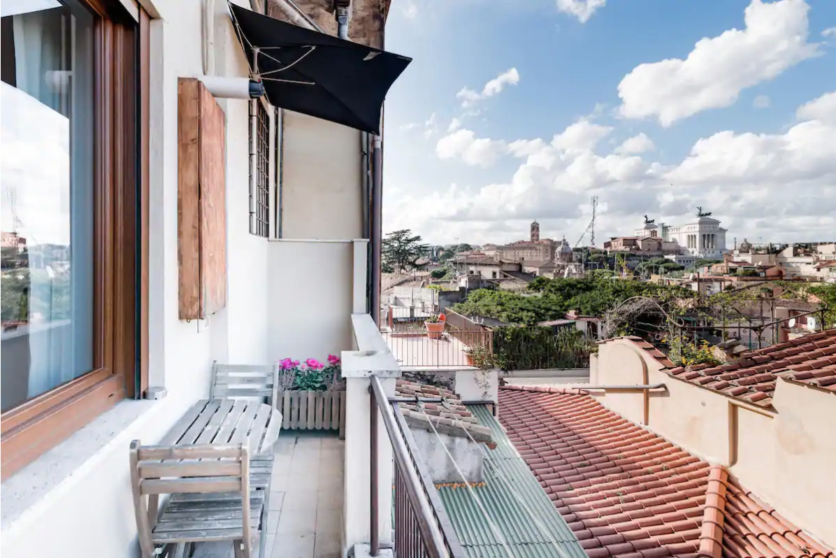 this airbnb in rome has stunning views of the rooftops of rome