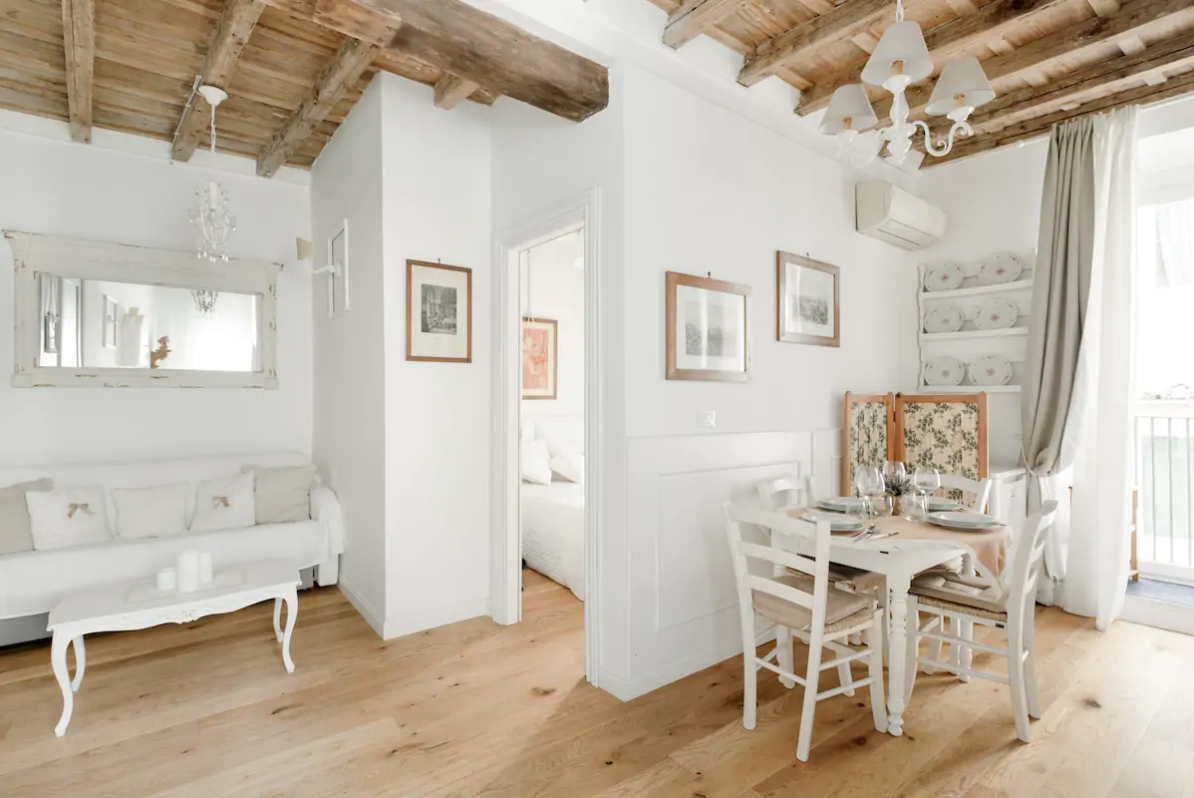 this airbnb in rome is sdecorated with white walls and shabby chic style