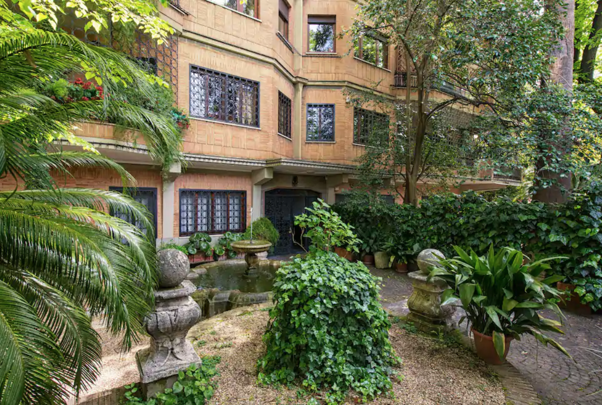 the exterior of this airbnb in rome looks like the setting of a rom com movie!