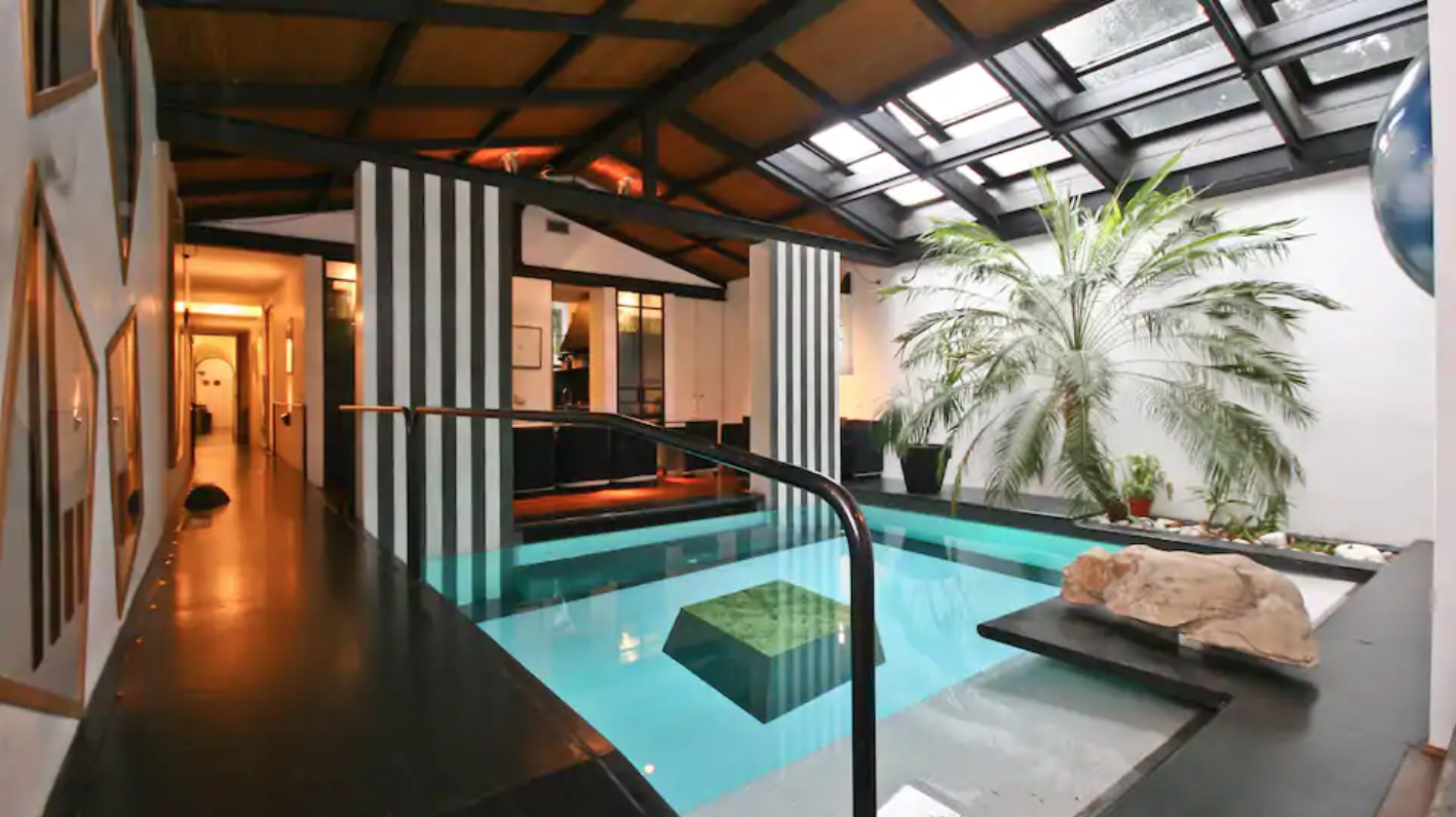 this airbnb even comes with a swimming pool in the dining room!