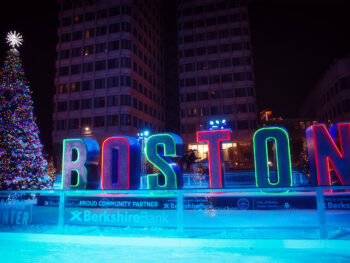 Photo of an outdoor ice rink in Boston during Christmastime.