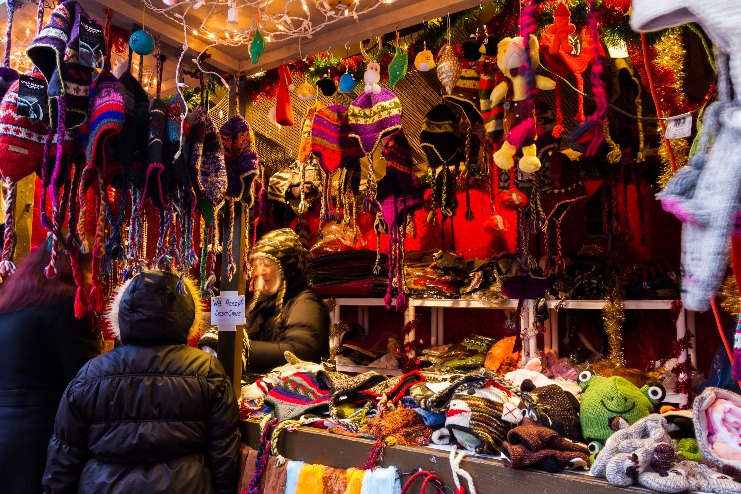 Photo of alpaca wool gifts vendor at a ChristKindl Market, one of the best Christmas markets in the USA.