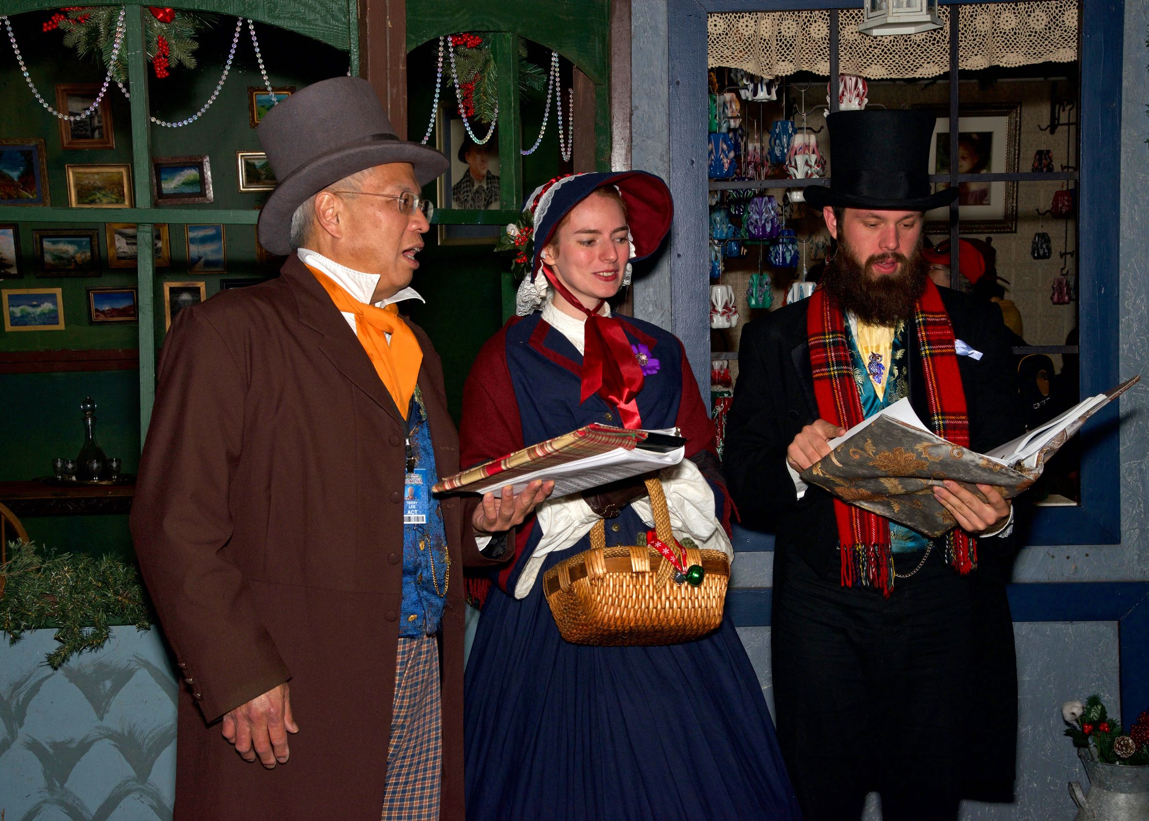 Photo of costumed Victorian carolers at the Dickens market in San Francisco.