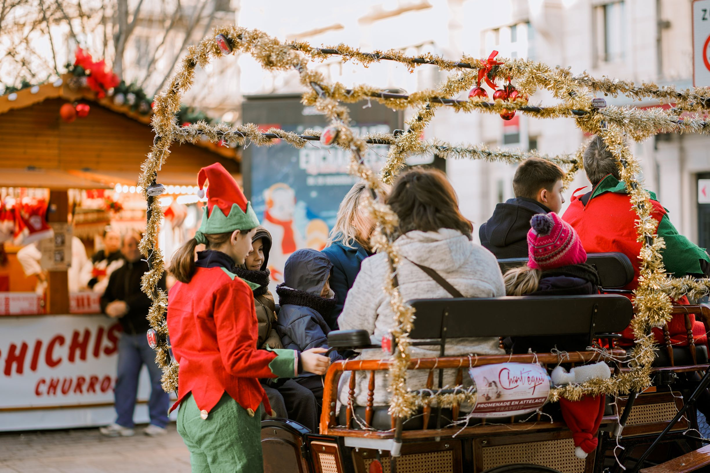 Photo of carriage rides with an elf at a Christmas market.