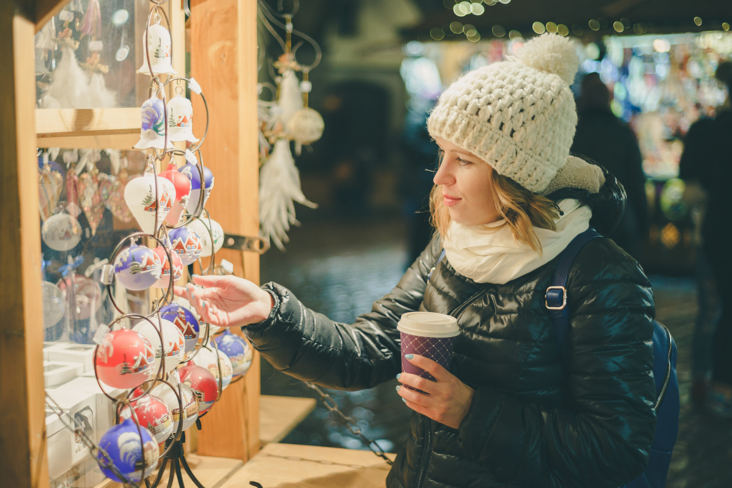 Photo of a woman looking at Christmas ornaments.