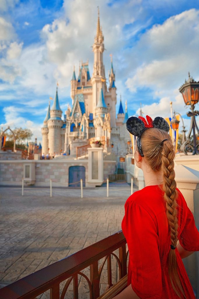 Photo of young woman looking at Cinderella's Castle in Disney World.