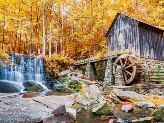 Photo of a historic mill and a waterfall in Marietta Georgia, one of the best places to experience Fall in Georgia.