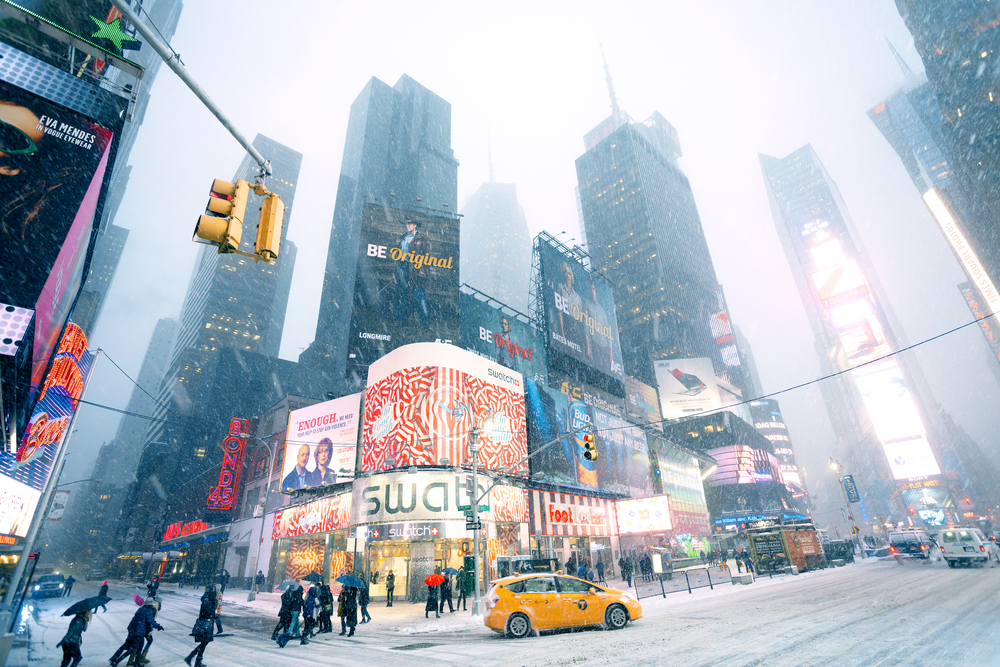 snow coating skyscrapers and billboards of New York City
