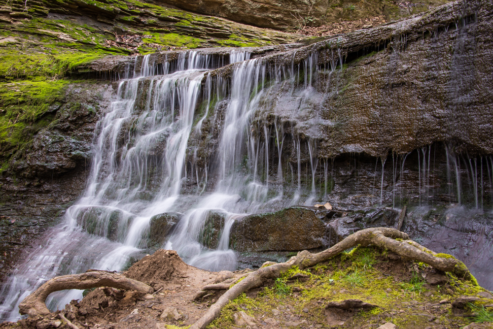 waterfall cascading down rock wall at Natchez Trace State Park