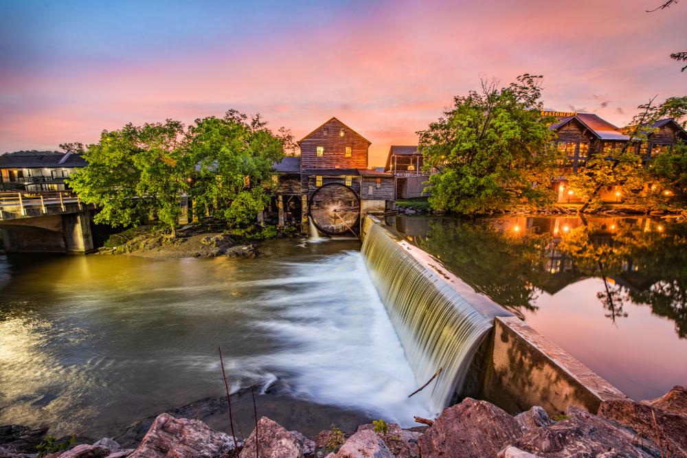 old buildings lining a small river in Pigeon Forge