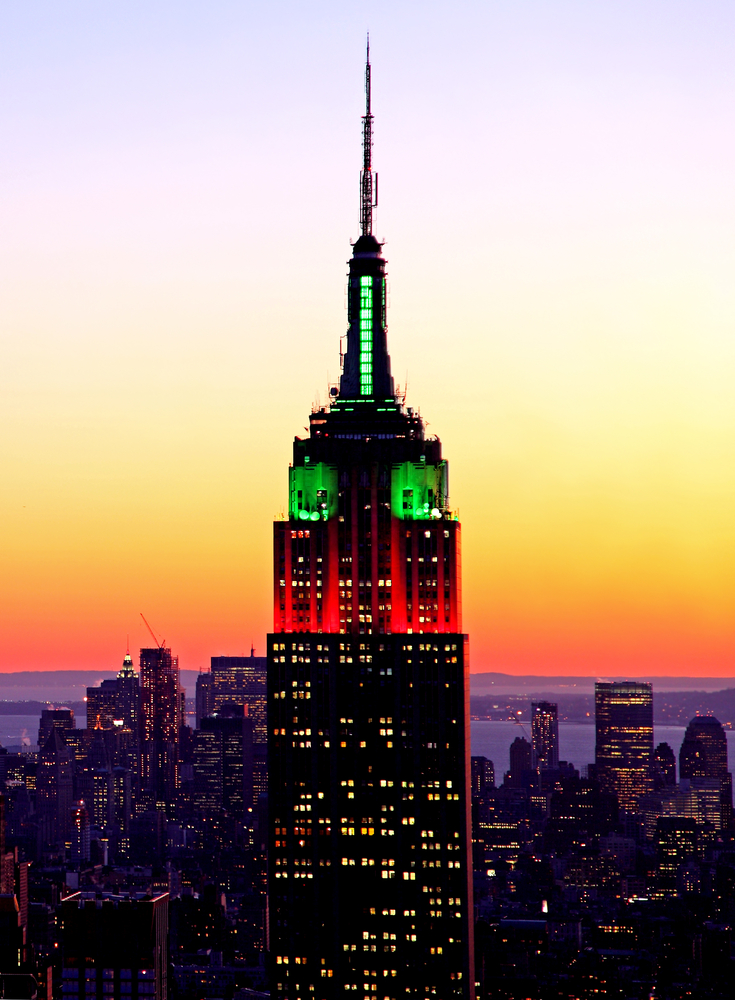the Empire State Building illuminated in the seasonal Christmas holiday colors of red and green